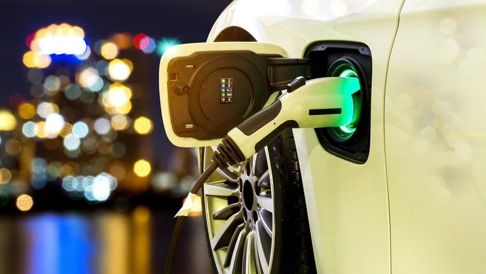 Electric Vehicle (EV) Charging in Front of Cityscape